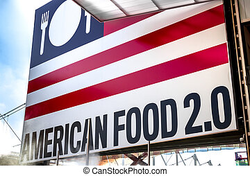 Signboard american food near a trade show dedicated to food.