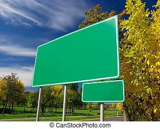 Signboard - Empty green signboard at the roadside in an...