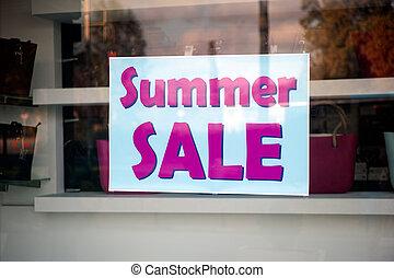 Signboard Summer sale in shop window