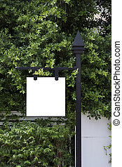 Signboard with green bush