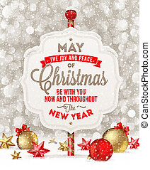 Signboard with holiday greeting and Christmas decoration on...