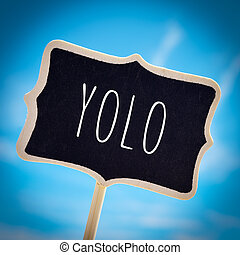 signboard with the word yolo, vignetted