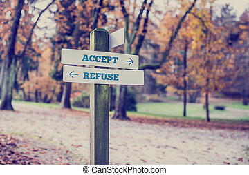 Signboard with two signs saying - Accept - Refuse - Rural...