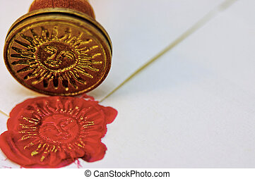 Signet, red wax and envelope