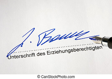 signing a formal document - handwritten signature on an ...
