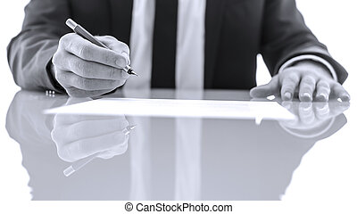 Signing and reading legal papers - Detail of businessperson...