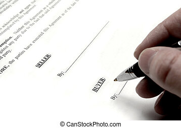 Signing Contract - Hand holding pen signing a purchase...