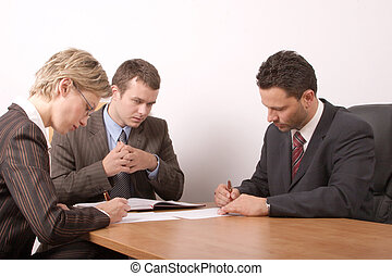signing contract - Business meeting - 2 men, 1 woman, -...