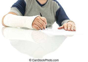 Closeup of broken male hand in plaster signing insurance claim.