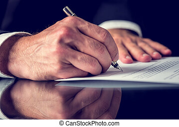 Signing mortgage papers - Closeup of male hand signing...