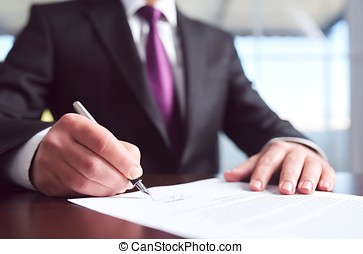 Signing Official Document - Businessman Signing An Official...