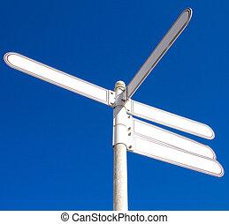 Signpost against blue sky