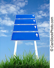 signpost and blue sky