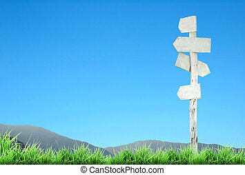 signpost with blue sky
