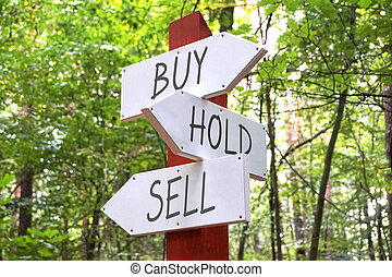 Signpost with three arrows - buy, hold, sell
