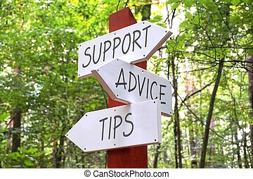 Signpost with three arrows - support, advice, tips concept