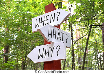 Signpost with three arrows - when, what, why questions