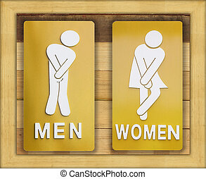 Signs female and male bathroom on wooden background