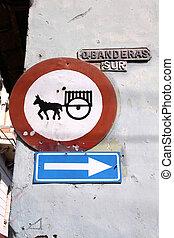 """Sancti Spiritus, Cuba - Banderas street sign and """"no horsedrawn carts"""" sign."""
