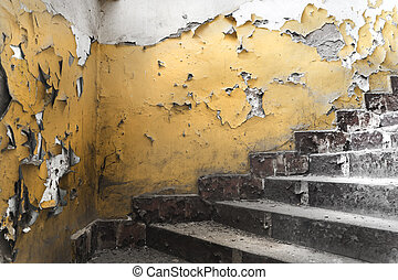 Signs of passing on the walls and stairs in an old abandoned sov