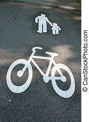 Way for pedestrians and bicycles - painted signs on asphalt