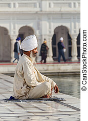 Sikh in a obliteration prayer In the lotus position