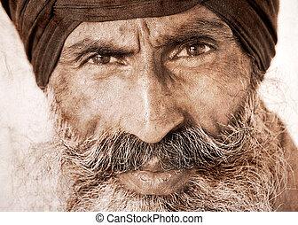Sikh man in Amritsar, India. Artwork in retro style. -...