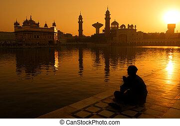 Sikh pilgrims at Golden Temple India - Sikh pilgrims sitting...