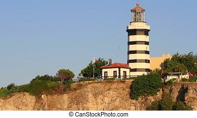 Sile lighthouse, Istanbul, Turkey. Tilt from hill to the sea...