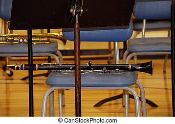Silence Is Golden - Clarinet laying on a vacant chair.