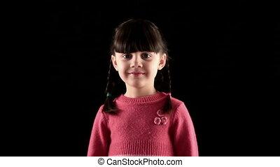 silent girl on black background