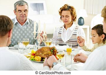 Silent pray - Portrait of big family sitting at festive...