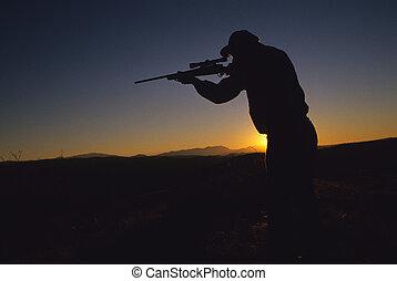 silhoette, disparando, cazador