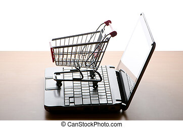 Silhoette of shopping cart and laptop