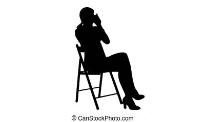 Silhouette A young attractive woman with a cup of coffee or tea on laptop