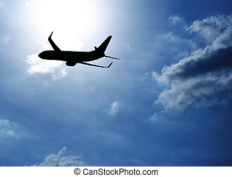 Silhouette airplane in blue sky - Picture of silhouette...