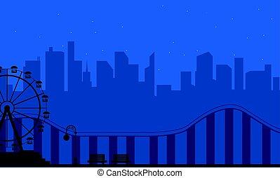 Silhouette amusement park at night scenery