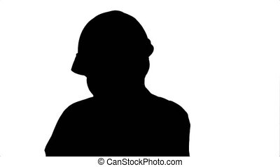 Silhouette Angry woman construction worker in a hardhat shouting, talking on smartphone.
