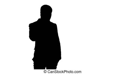 Silhouette Arab business man talking on the mobile phone....