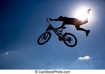 Silhouette biker blue sky