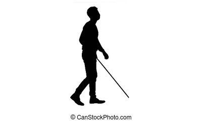 Wide shot. Side view. Silhouette Blind Man In Medical Mask Walking. Professional shot in 4K resolution. 53. You can use it e.g. in your medical, commercial video, business, presentation, broadcast