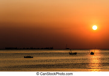 silhouette boat in the sunset time