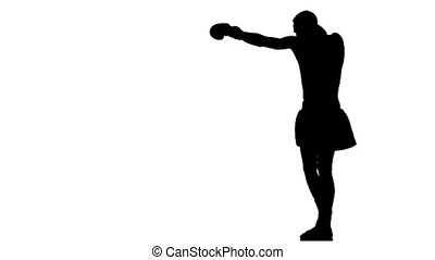 Silhouette. Boxer is right fulfills punches. Slow motion