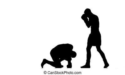 Silhouette boxer knocked down