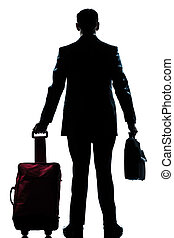 silhouette business traveler man with suitcase  rear view