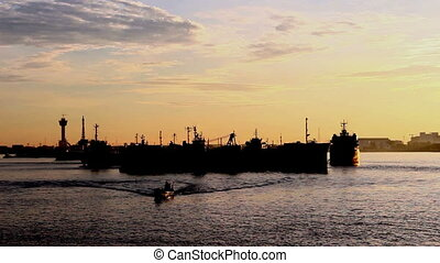 Silhouette cargo ship in morning - Silhouette cargo ship...