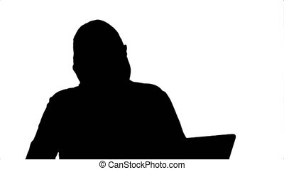 Silhouette Celebrating success, excited business woman start to dance, working on laptop.