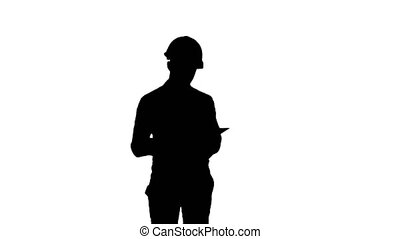 Silhouette Civil engineer filing in inspection form. 065s....