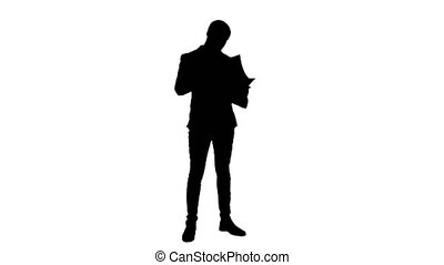 Silhouette Concentrated businessman reading important...