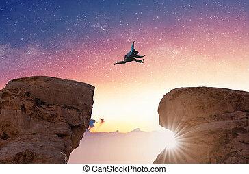 silhouette, concept., freiheit, aus, herausforderung, einbildungskraft, springende , mann, überfahrt, abgrund, risiko, felsformation